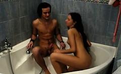 This teen brunette loves feeling hot water run down her