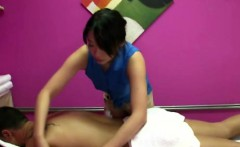 Real asian masseuse massaging customer