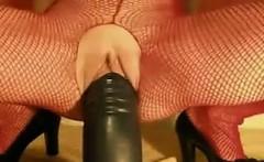 slut riding a big black dildo