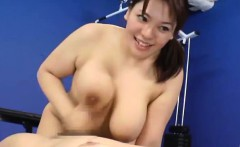 Mizuki Ann rubs cocks with huge assets