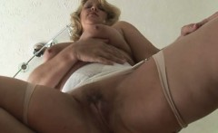 Busty blonde Milf in open girdle and stockings