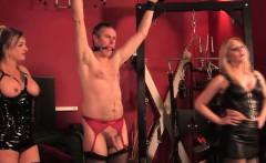 Three latex femdoms dominate some sissy dude