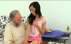 Old dude stuffs mouth of a young playgirl with his jock