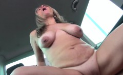 Blonde MILF enjoys herself during car sex, sucking dick