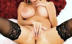 Big breasted beauty in black stockings gives it to herself