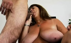 Hot BBW Mercy slips out of her red dress to reveal giant melons and kneels to take a cock into her mouth