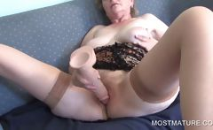 Mature masturbating with dildo