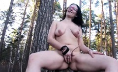 Liza naked and fingering in the forest