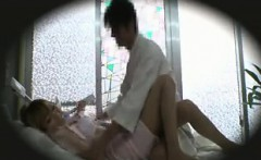 Spy cam catches an Asian masseuse getting on her back and f