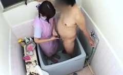 Adorable Asian babe offers a chubby guy a great handjob in