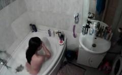 amateur brunette in tub voyeur video