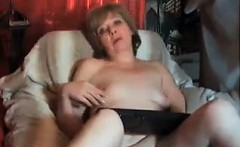 Blonde granny filmed in solo action
