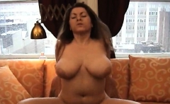 Gorgeous babe oils up her big milk sacks and gives tit fuck