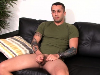 Army stud with great tattoos tugs his big cock with passion