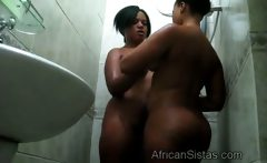 Big black hotty lesbo gets pleasef by hot African in shower