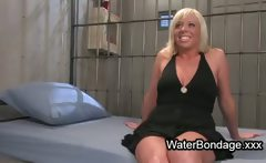 Tied up blonde dive into tub in prison