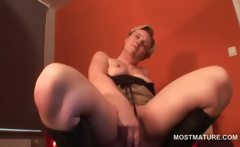 Mature blonde fucking herself with her favorite sex toy