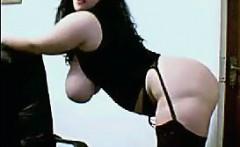 Big Busty Woman Masturbates With A Dildo
