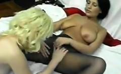 Beautiful Lesbians Sharing A Long Dildo