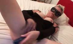 Masked blonde mature doing herself with dildo