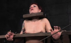 Redhead sub caned and clit stimulated