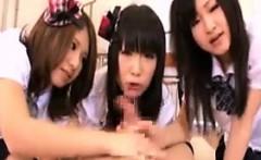 Naughty Oriental schoolgirls work their lips on a hard pole