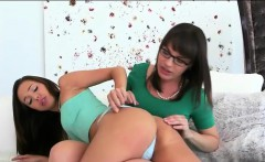 Hot momma with glasses licking teen sweet pussy on sofa