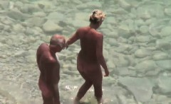 Handjob given by mature wife on public beach