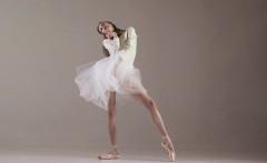 Blonde gymnast performs gymnastics