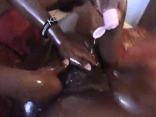 Naughty Afro babe spreads oil all over her girlfriends