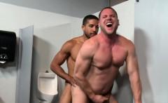 Mike Maverick fucks with Hans Berlin in a glory hole room