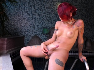 Redheaded Tgirl Masturbates by the Pool