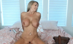 Busty cougar masturbating