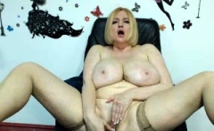 Hot busty blonde milfs in stockings toys with her cunt