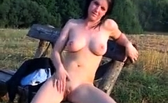 Outdoor striptease with nice boobs