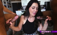 Horny milf is seduced into taking two loaded black cocks