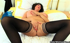 British and busty milf Fiona puts her dildo to work