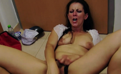 Arousing brunette uses a toy while masturbating