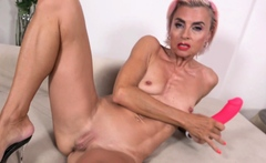 Skinny mature Sunny stretches her tight pussy with dildo